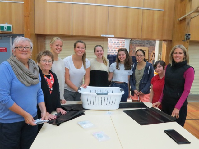 St Mary Star of Sea Z club members pack birthing kits  with members of the Zonta Club of Wollongong